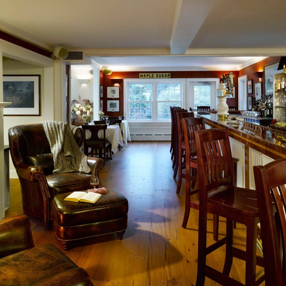 Bar Drink chair property Dining home hardwood living room cottage mansion condominium recreation room dining table