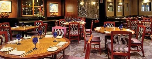 Drink Eat chair restaurant Bar Dining function hall dining table