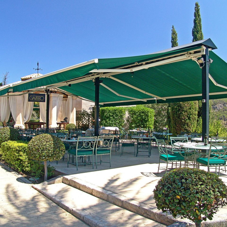 Bar Dining Drink Eat Lounge sky ground green property outdoor structure gazebo Villa cottage sign Resort Garden day