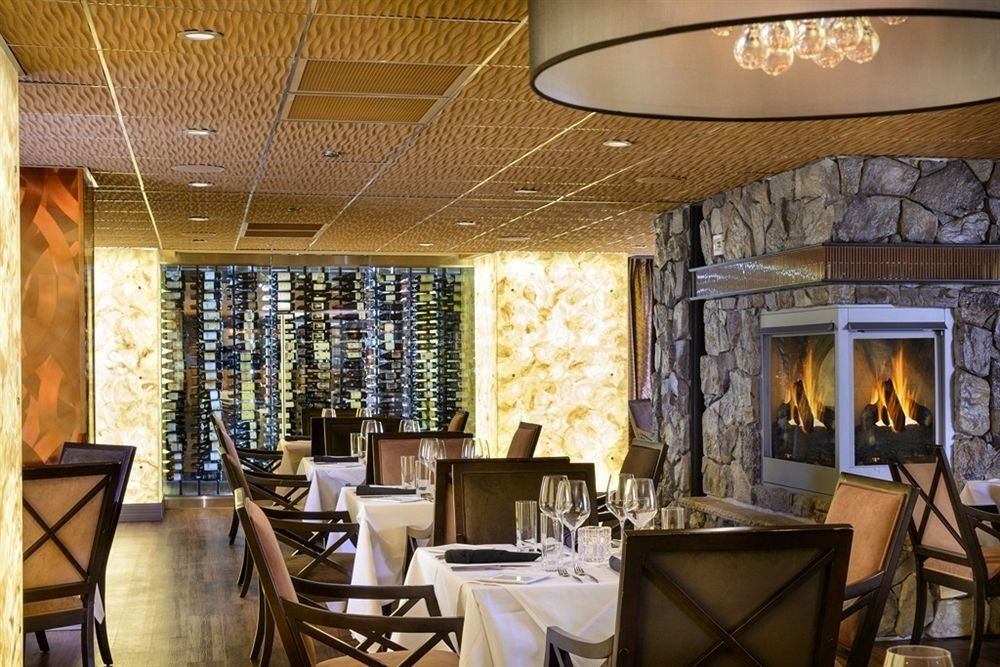 Drink Eat chair property restaurant Lobby Fireplace living room Dining Bar function hall café