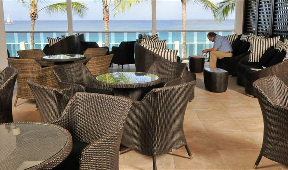 Bar Dining Drink Eat Modern chair property living room home sofa Suite condominium restaurant wicker Villa Lobby seat