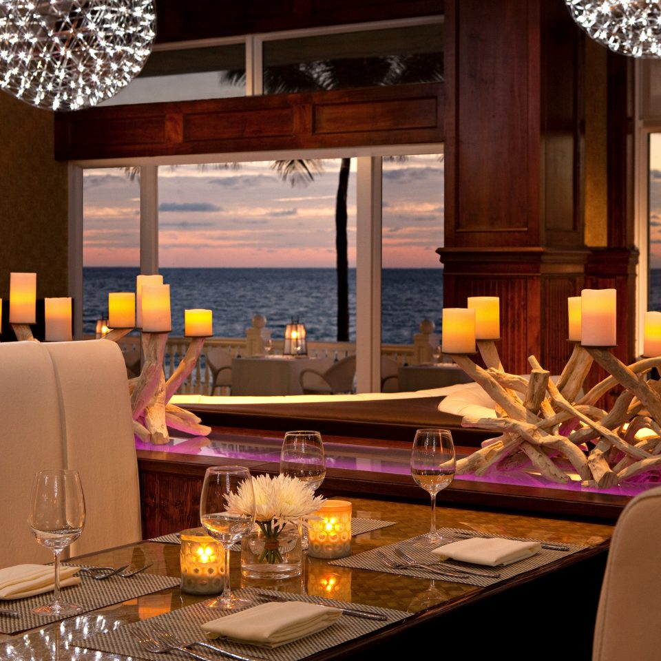 Dining Drink Eat Modern Resort Scenic views Sunset Waterfront restaurant home living room lighting Bar Suite yacht dining table