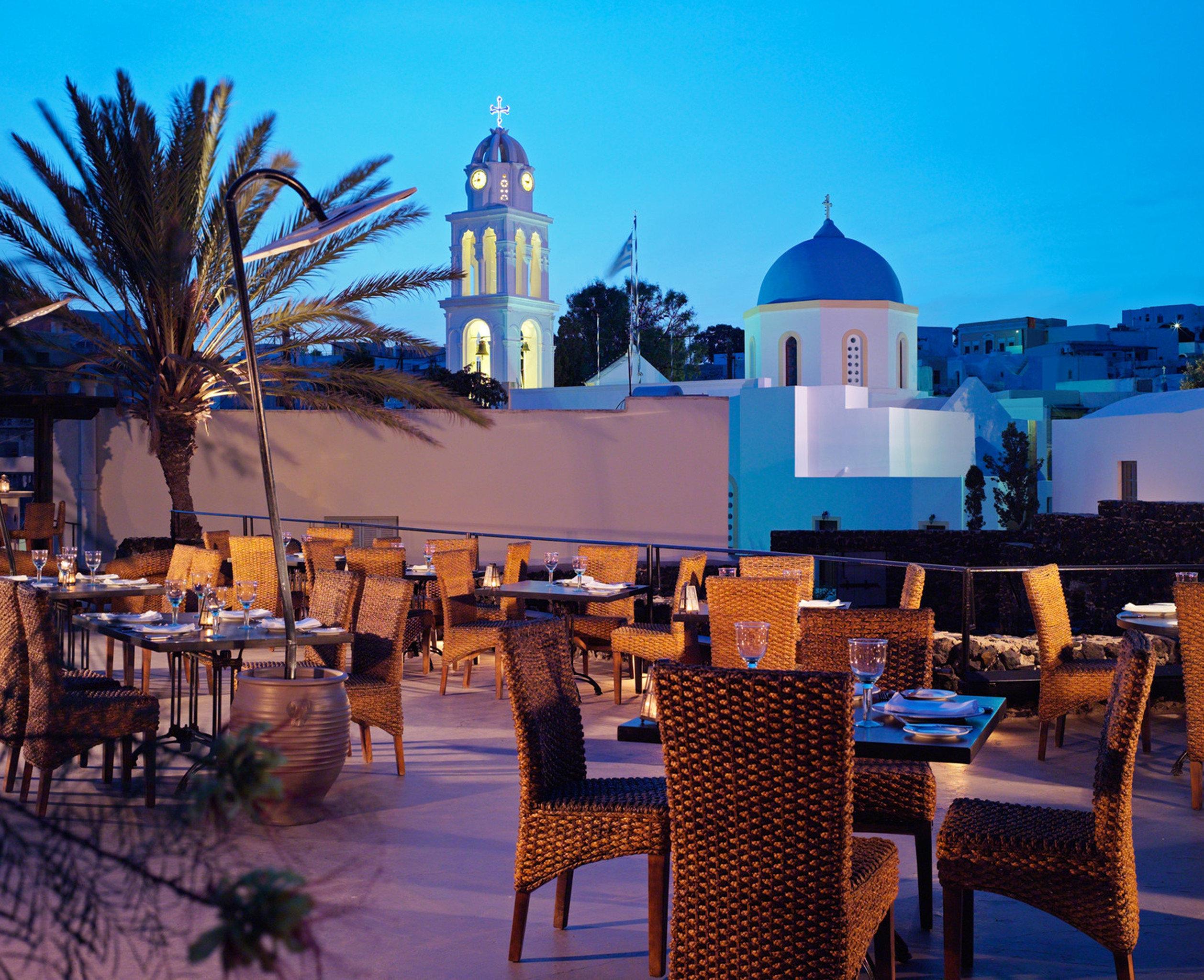 Bar Dining Drink Eat Luxury Romantic sky chair umbrella Resort restaurant evening palace surrounded