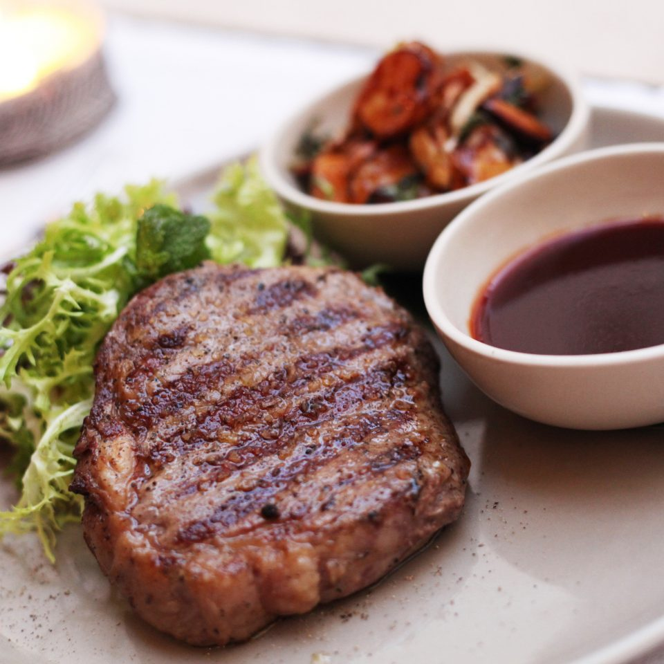 Bar Dining Drink Eat Romantic plate food meat steak fried food cuisine sirloin steak breakfast pork chop rib eye steak animal source foods lunch piece de resistance