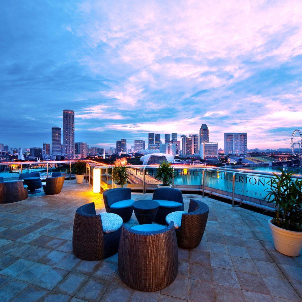 Bar Dining Drink Eat Hip Modern Romantic sky scene horizon swimming pool cityscape evening skyline marina dock dusk Resort Sea waterway