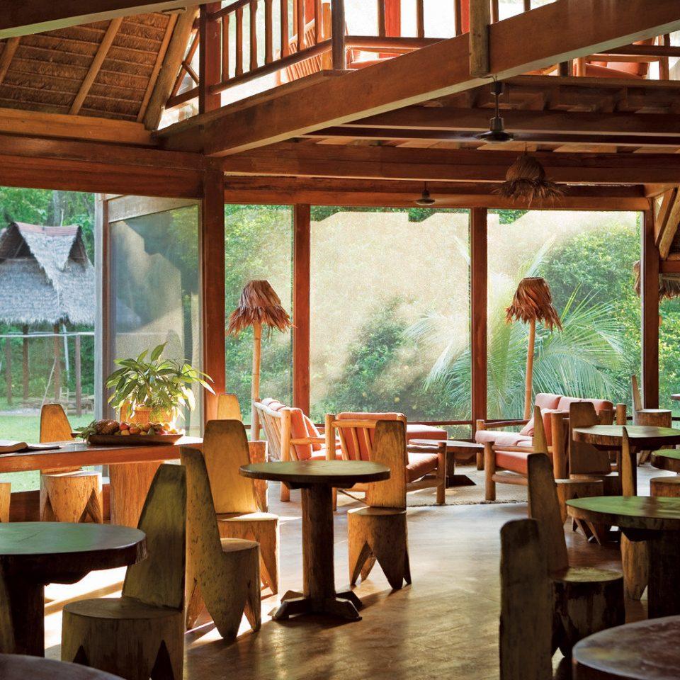 Dining Drink Eat Eco Forest Jungle Lodge Rustic restaurant wooden Resort tavern home cottage Bar dining table