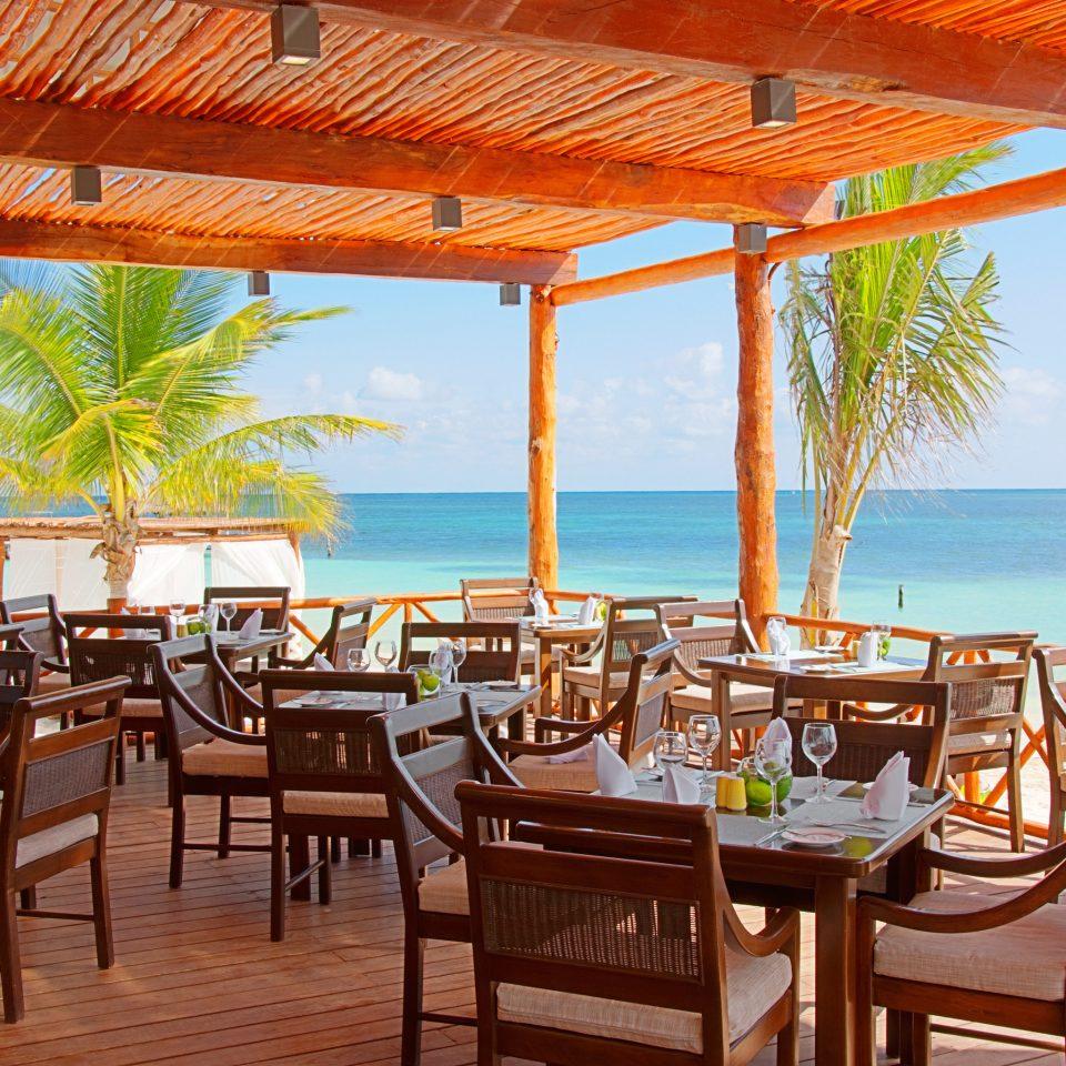 Bar Dining Drink Eat Hip Luxury Modern Romantic chair umbrella Resort property leisure restaurant caribbean Villa hacienda eco hotel cottage set Island dining table