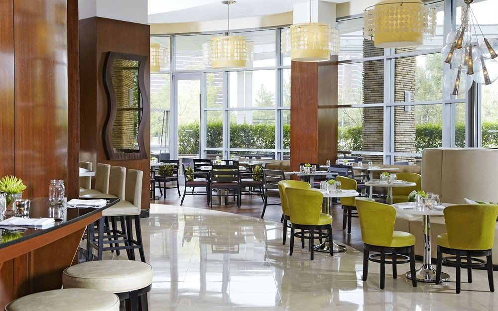 Bar Dining Drink Eat Hip Modern chair restaurant property cafeteria condominium Lobby function hall café dining table