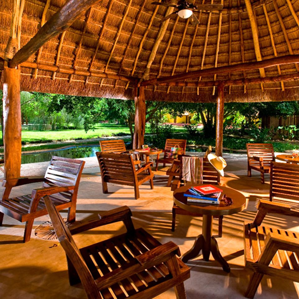 Bar Dining Drink Eat Luxury Rustic chair Resort wooden outdoor structure eco hotel Villa cottage restaurant set