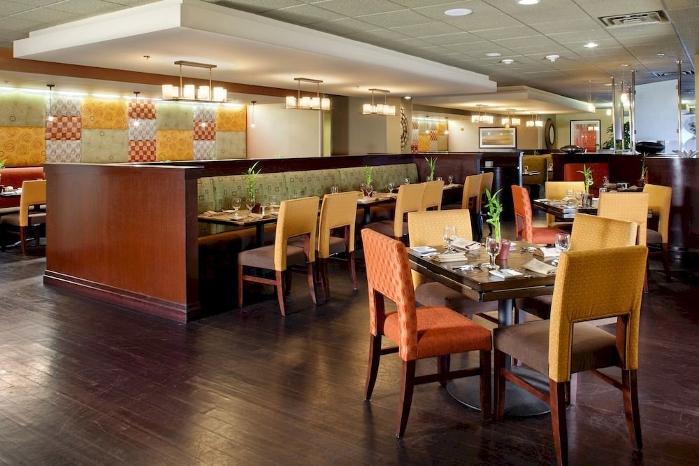 Dining Drink Eat Resort chair restaurant cafeteria Lobby café function hall Bar flooring food court