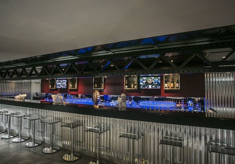 Bar Dining Drink Eat Hip Luxury structure sport venue display device auditorium stage stadium arena music venue signage restaurant long line