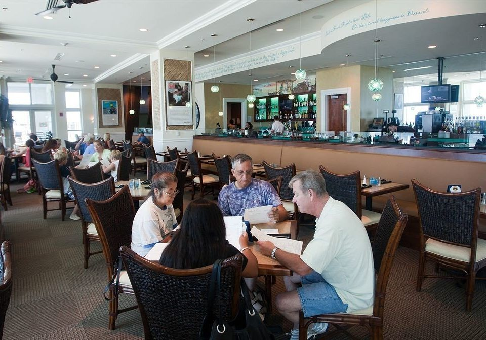 Bar Dining Drink Eat sitting chair laptop office working restaurant seated food court