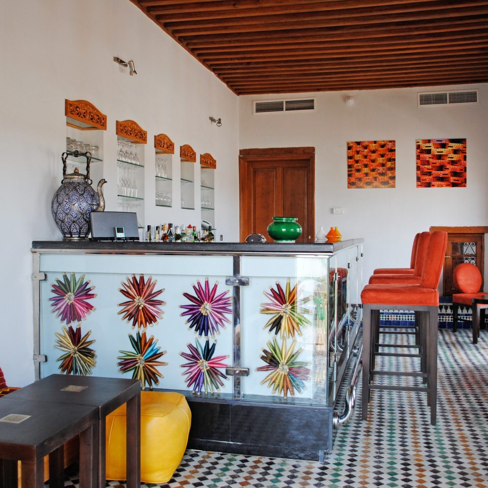 Bar Dining Drink Eat Historic Luxury Resort property chair living room house home cottage Villa orange restaurant hacienda colorful