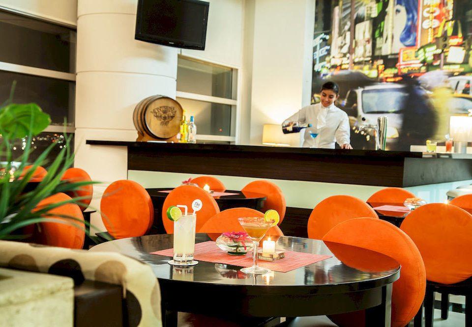 Bar Dining Drink Eat Hip color orange restaurant home living room brunch