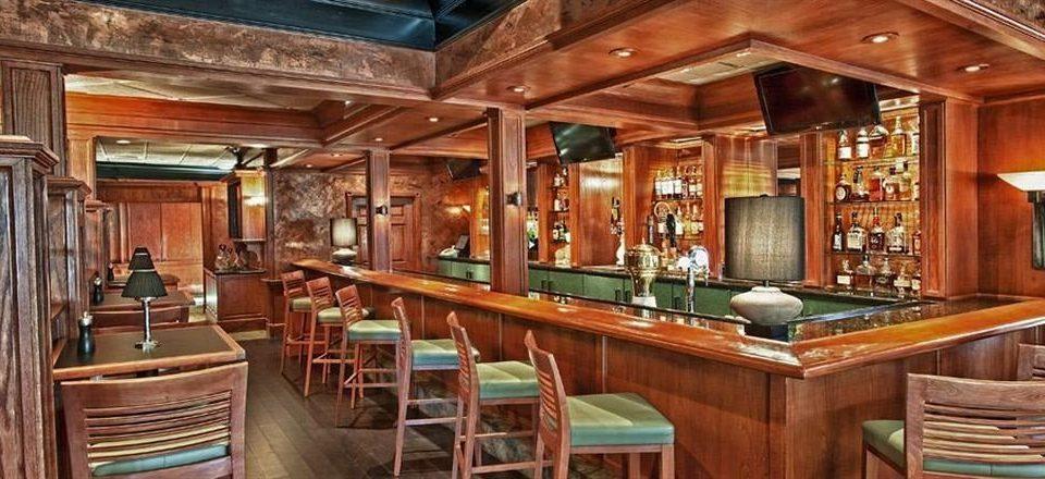 Bar Dining Drink Eat Elegant Luxury chair Kitchen property wooden billiard room recreation room home log cabin cottage Resort mansion Island