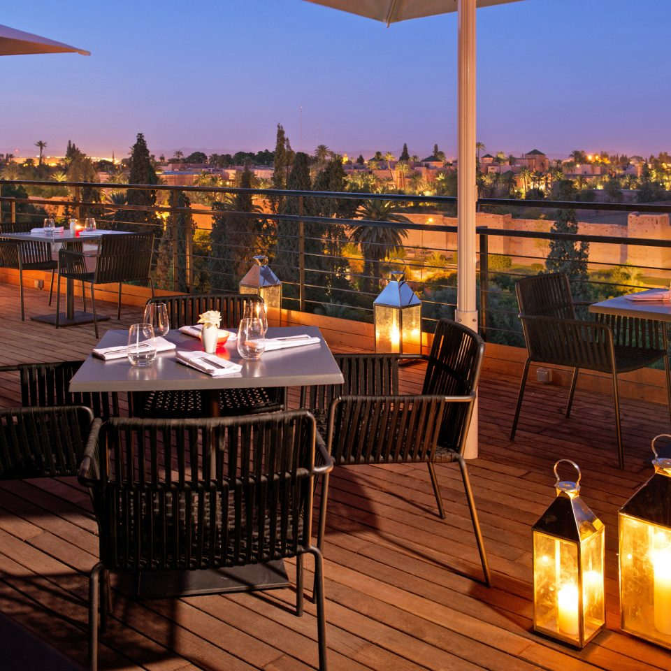 Dining Drink Eat Rooftop Scenic views sky chair restaurant Resort evening Bar