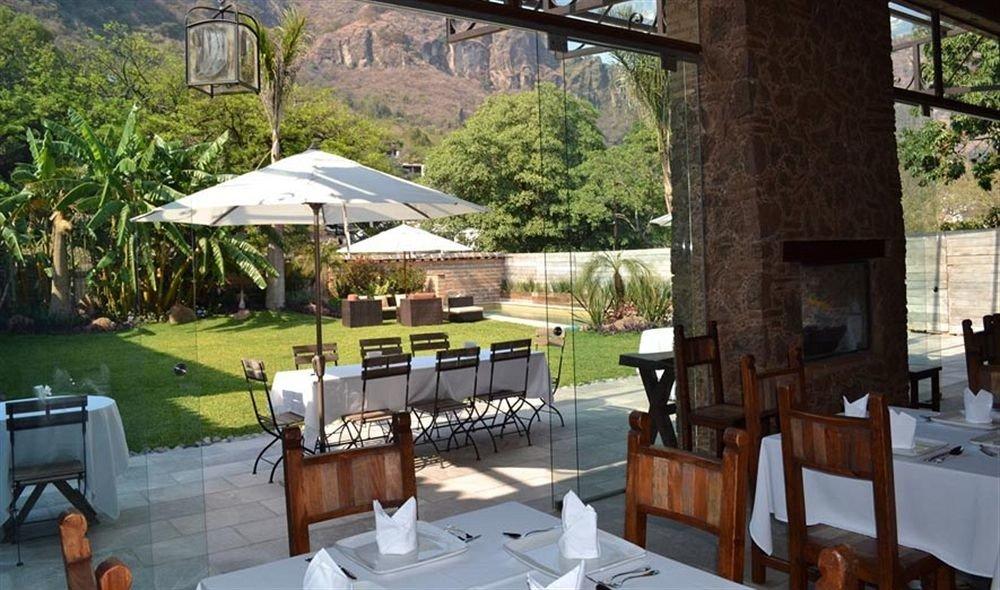 Bar Dining Drink Eat Scenic views tree property restaurant Resort cottage Villa