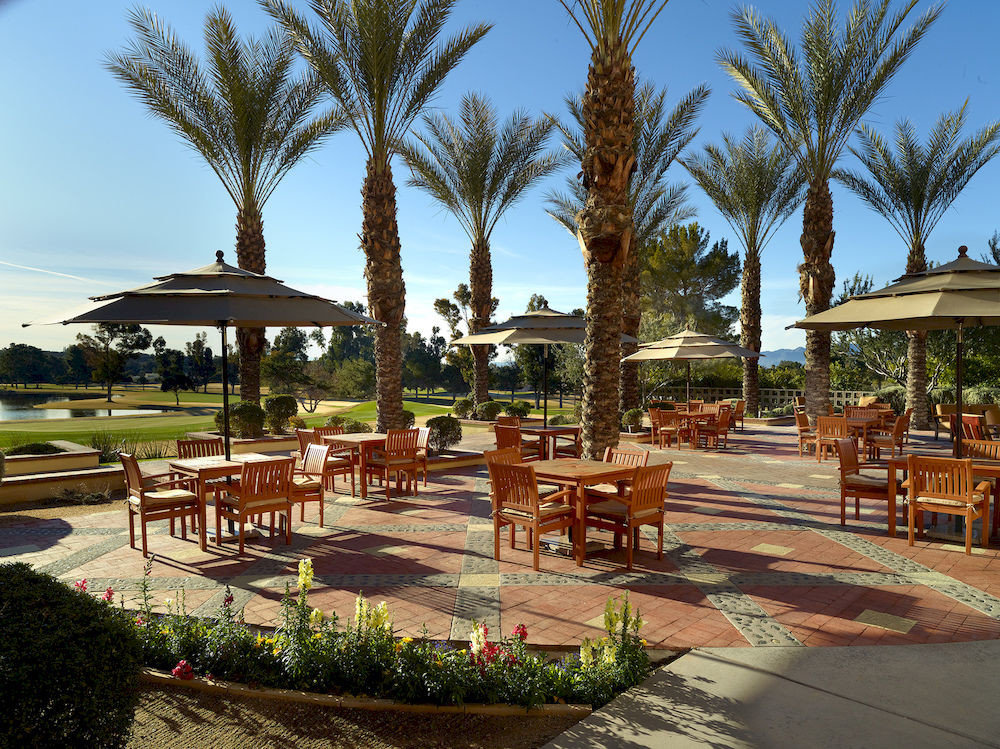 Bar Dining Drink Eat Luxury sky tree Resort property arecales plaza hacienda palm swimming pool walkway Villa condominium palace plant lined