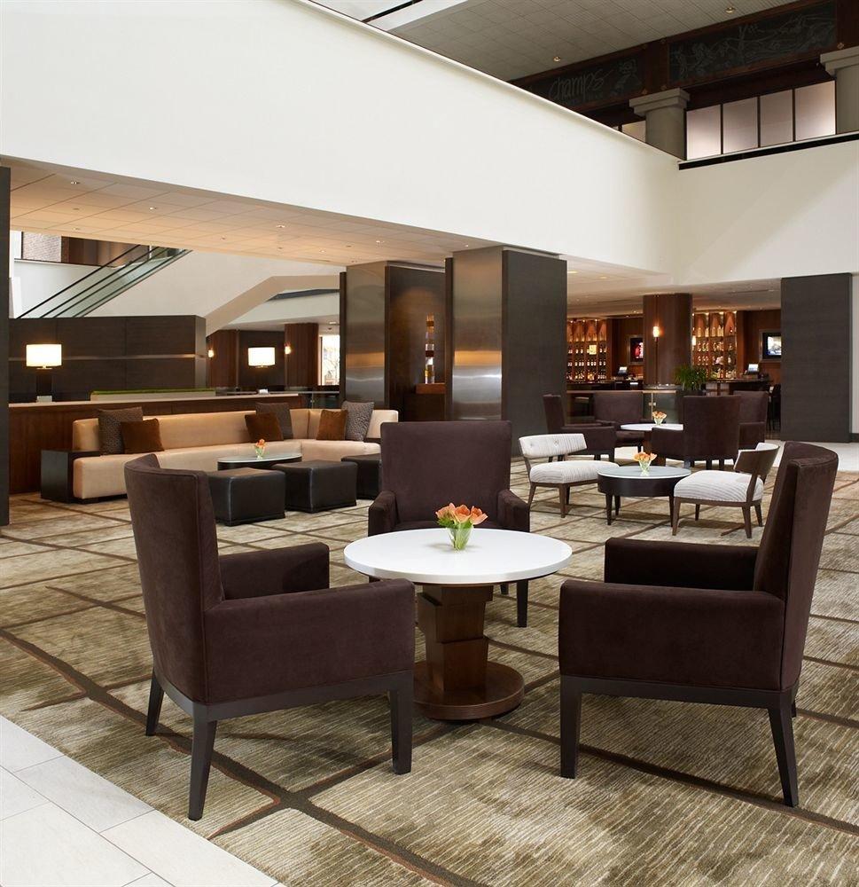 Bar Dining Drink Eat Luxury living room chair property Lobby hardwood home condominium flooring