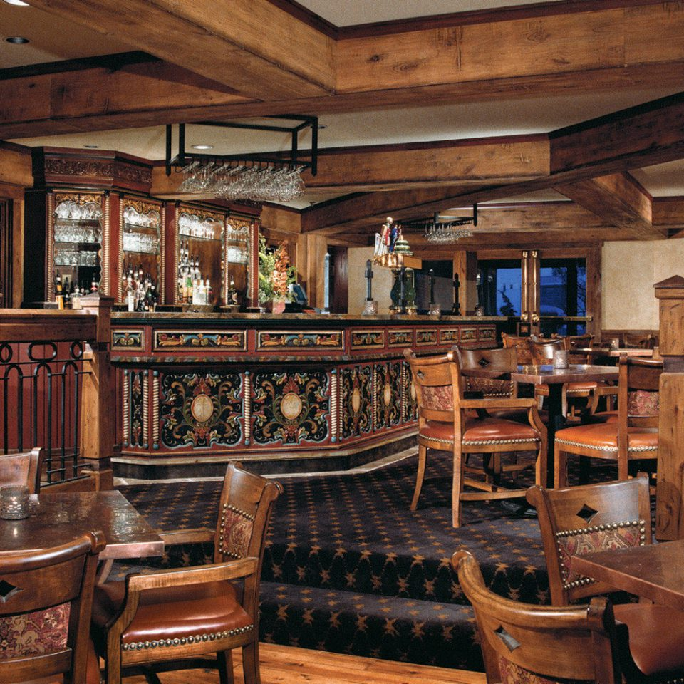 Dining Drink Eat Hotels Lodge Luxury Travel Mountains + Skiing Rustic Kitchen chair building Bar tavern restaurant home mansion Winery appliance stainless Island steel dining table