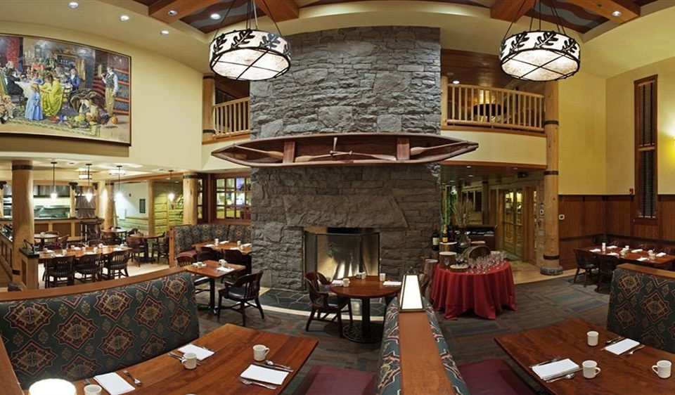 Dining Drink Eat Fireplace Lodge Rustic property chair Lobby restaurant Resort living room Bar mansion