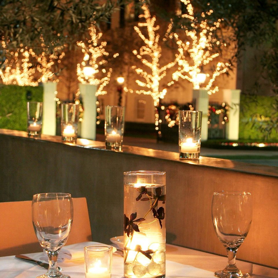 Bar Dining Drink Eat Elegant glasses wine restaurant lit lighting light centrepiece night dinner