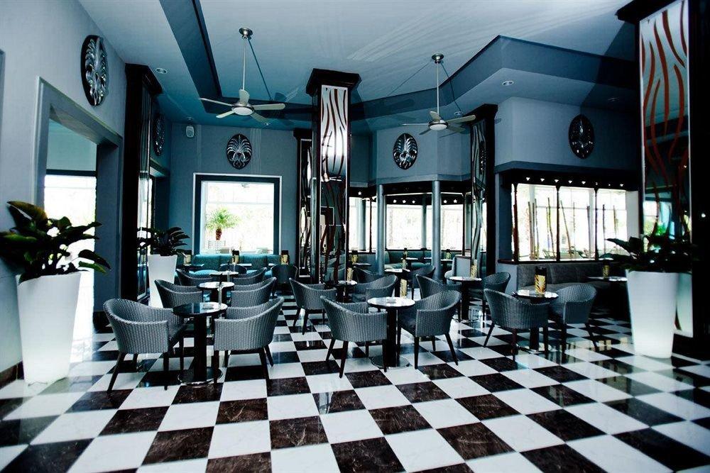 Bar Dining Drink Eat Elegant Hip Luxury Modern black restaurant indoor games and sports tile tiled stone