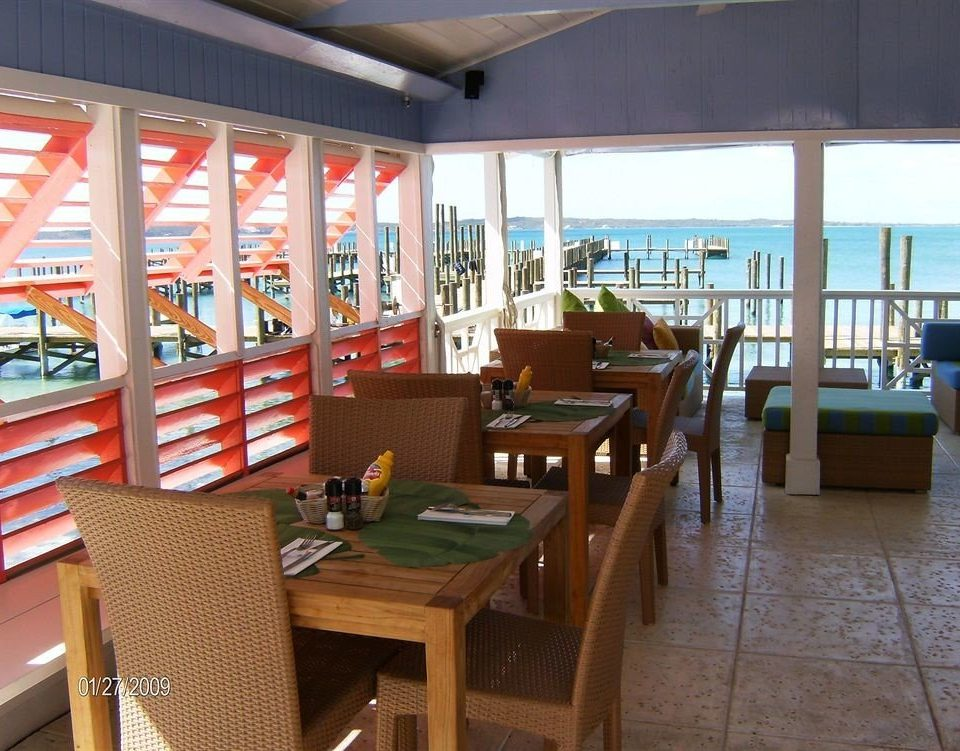 Bar Dining Drink Eat Scenic views Waterfront chair property restaurant Resort