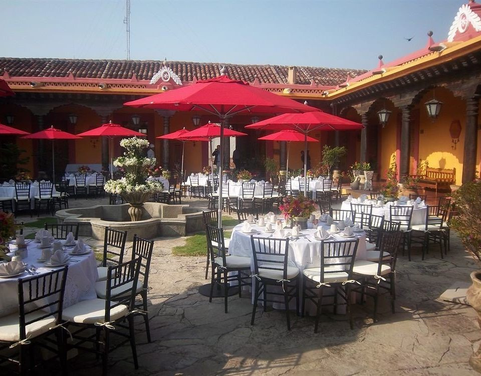 Bar Dining Drink Eat Rustic building sky umbrella ground chair restaurant function hall banquet Resort hacienda lawn set