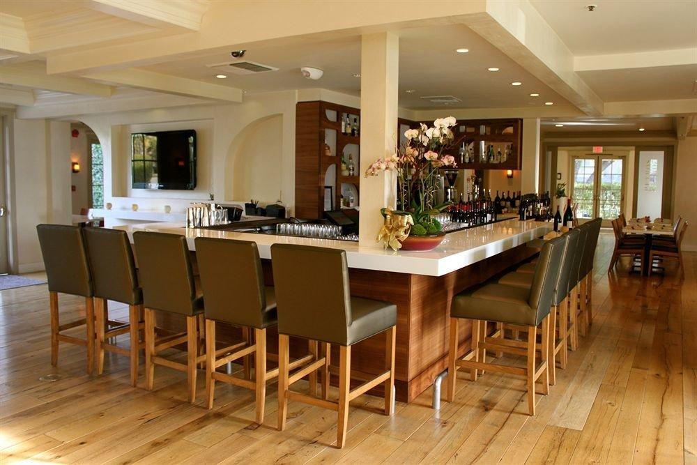 Bar Drink Eat Wine-Tasting chair property Dining hardwood restaurant home function hall recreation room cottage Island