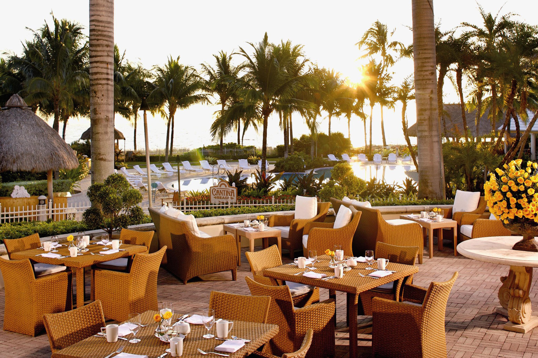 Bar Dining Drink Eat Elegant Luxury Scenic views Tropical sky tree chair restaurant Resort plant set