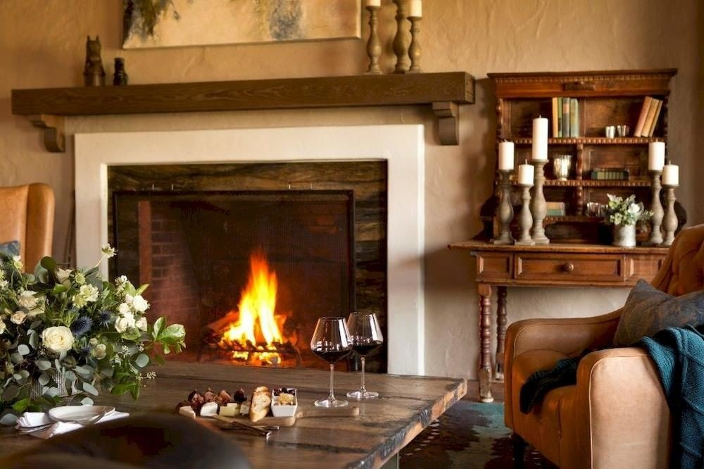 Bar Dining Drink Eat Hip Fireplace fire hearth building Nature home living room hardwood cottage stone