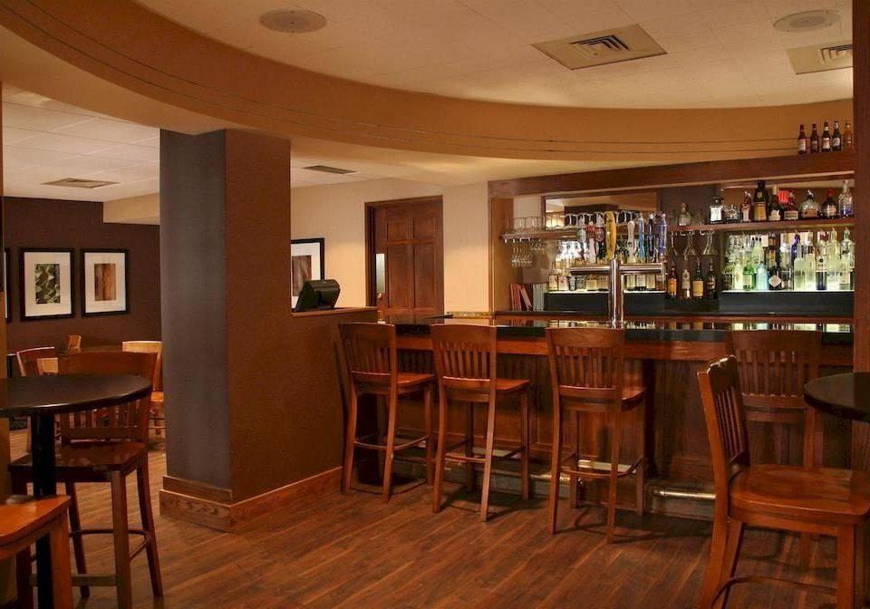 Bar Drink Resort chair Dining property hardwood recreation room restaurant dining table