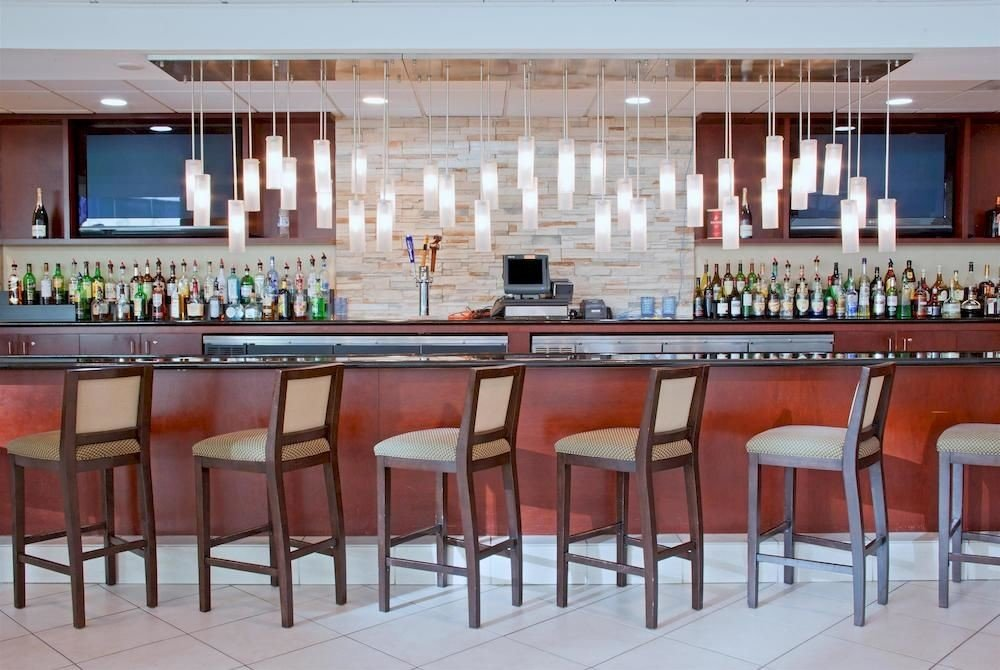 Bar Family chair property Dining restaurant cafeteria function hall convention center conference hall dining table
