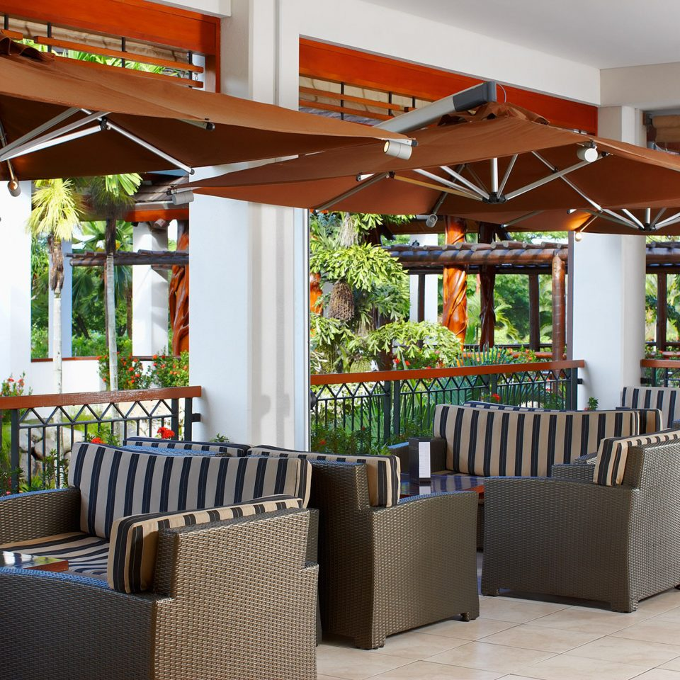 Family Lounge Outdoors Resort chair property restaurant Dining home porch outdoor structure Bar cottage