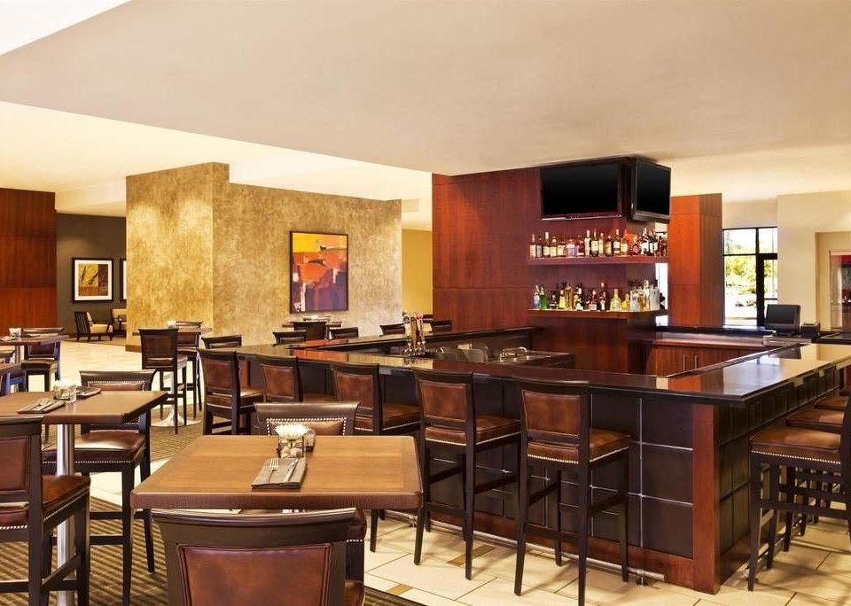 chair property Dining recreation room restaurant Bar cuisine set Island