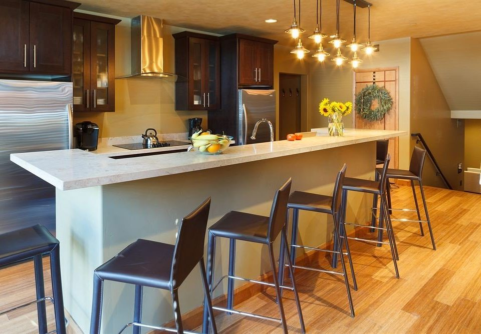 Kitchen property Dining hardwood home countertop cabinetry cottage Suite Bar Island