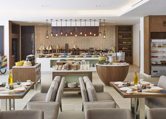 Kitchen property restaurant counter function hall cafeteria condominium Bar breakfast Dining living room conference hall Island