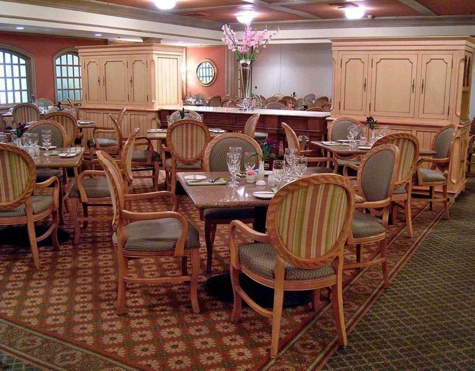 chair Dining Kitchen property restaurant Bar function hall set dining table surrounded Island