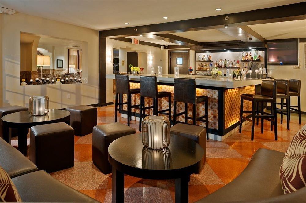chair property Dining restaurant Lobby café Bar Suite condominium living room Resort Island dining table
