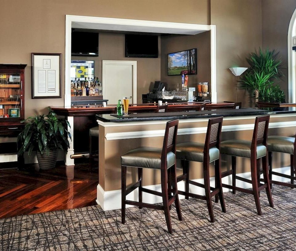chair property hardwood home Dining living room Kitchen flooring wood flooring cottage cabinetry Bar dining table