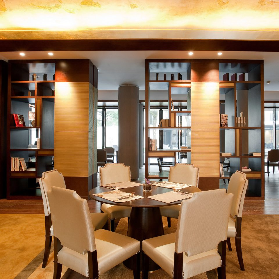 chair property Dining restaurant café living room Bar Lobby dining table