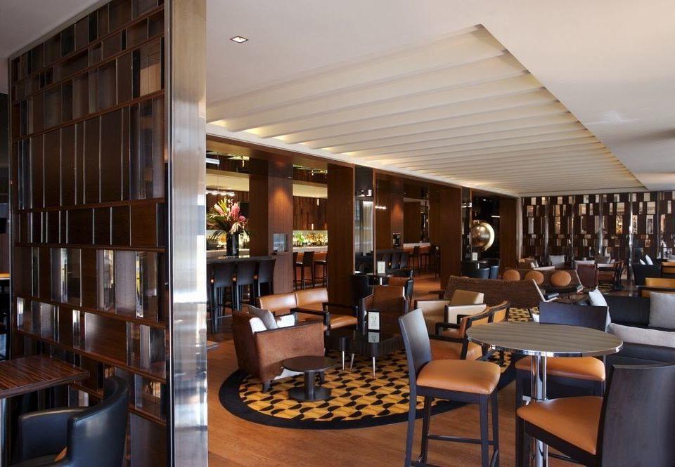 chair property Dining Lobby restaurant Resort condominium Bar Modern dining table