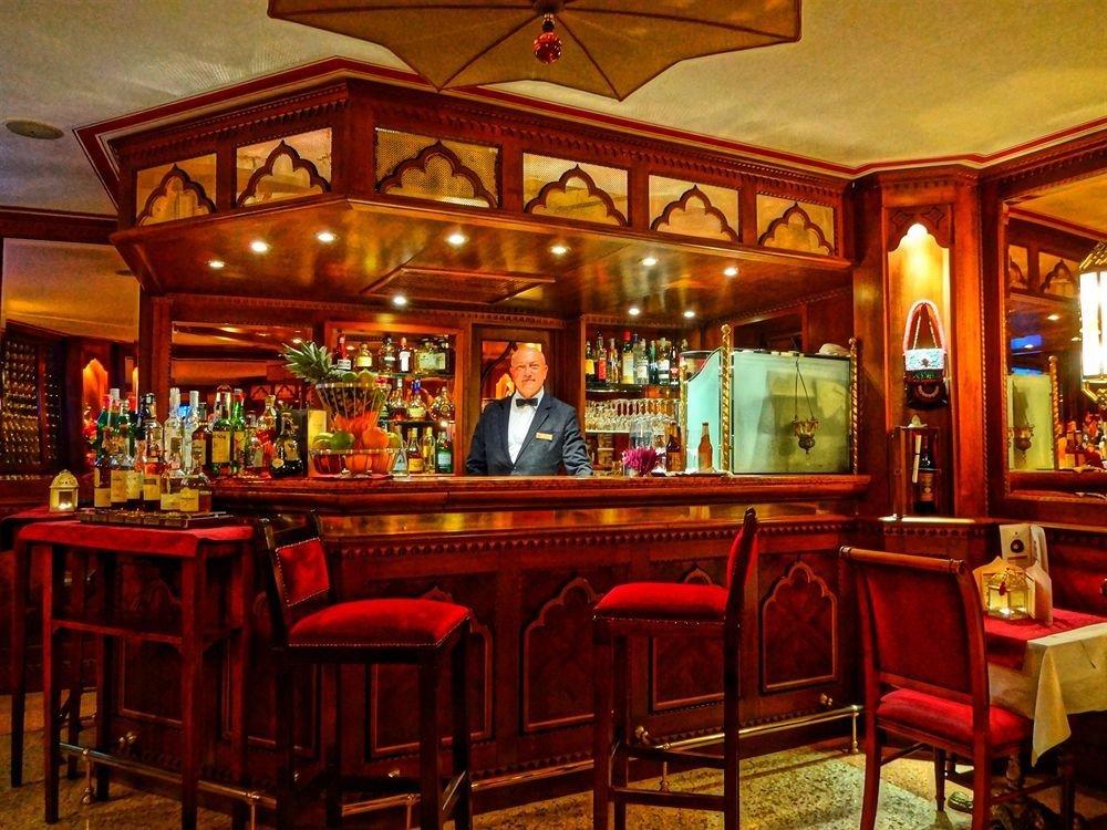 Bar red restaurant tavern function hall palace Dining café Resort dining table