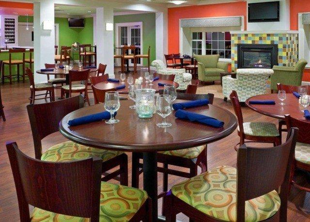 chair property Dining restaurant Resort condominium Bar set