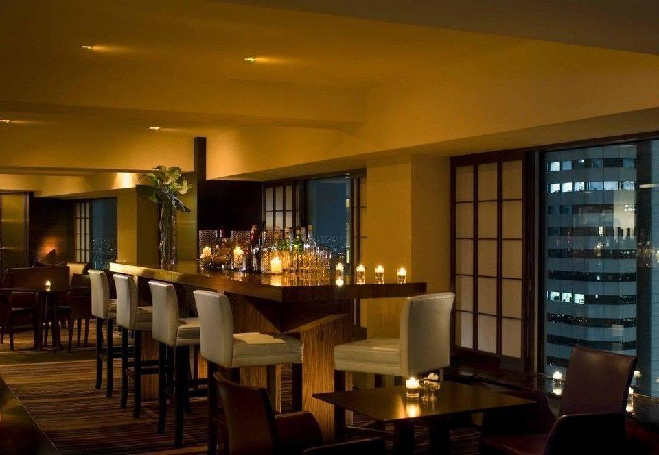 chair property Dining restaurant Bar lighting condominium Resort function hall dining table