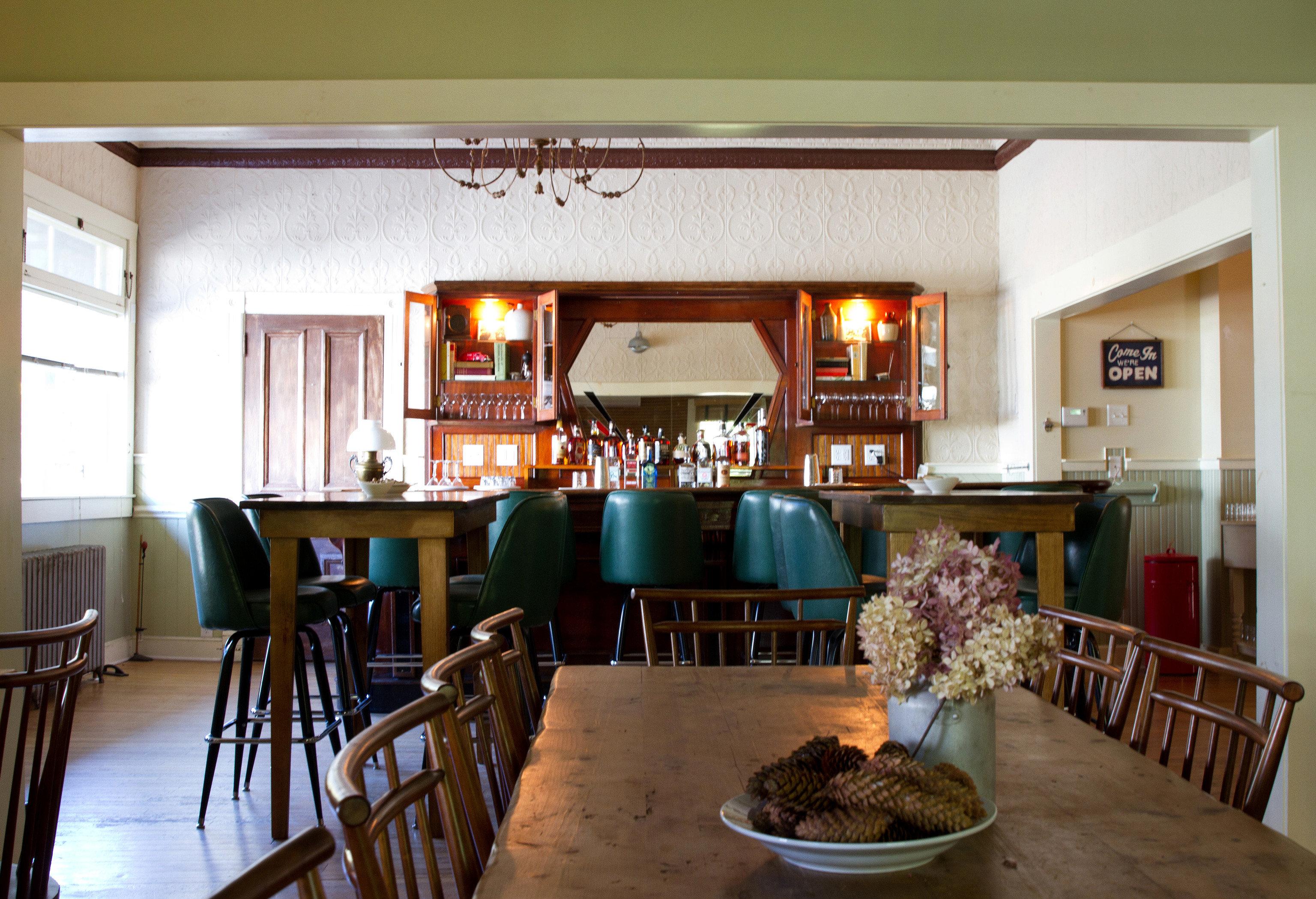 chair property Dining restaurant home Bar living room Resort