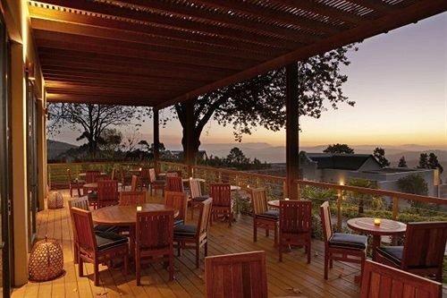 chair property restaurant Resort porch wooden Dining hacienda Bar set overlooking