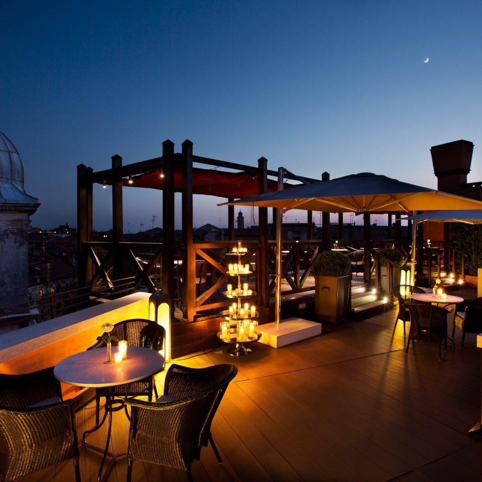 Dining Romance Romantic Rooftop chair night restaurant evening lighting Resort Bar