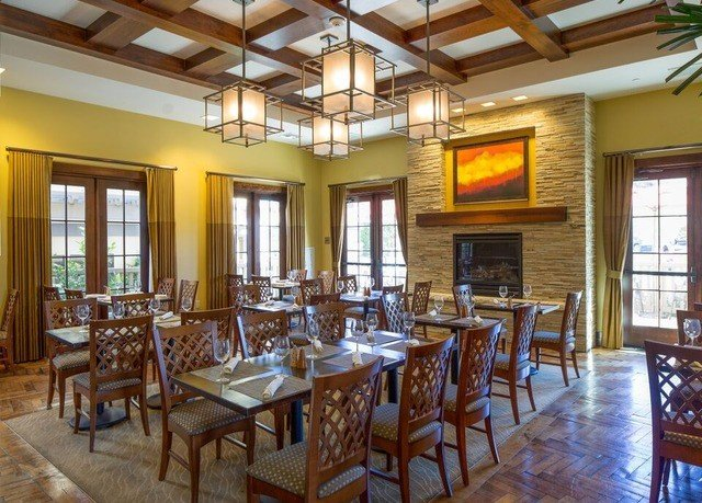Dining chair property Resort restaurant cottage Villa farmhouse Bar dining table